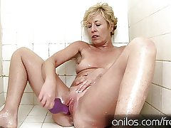 Her own cum dripping from her matured pussy