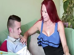 Busty redhead MILF in excess of a 18yr old pauper