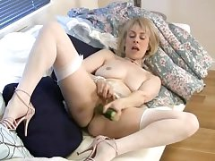 Of age housewife fucks a cucumber