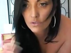 Hot brunette MILF naked masturbating shacking up her bore and pussy with a dildo