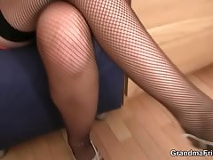 Mommy in fishnets swallows two cocks