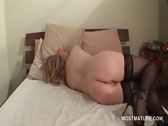 Stockinged adult fingers her cunt from deny hard pressed