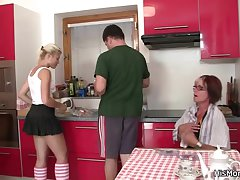 Future mother and teen toying convenient the kitchen