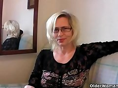 Slutty grandma in the air stockings fists her hairy cunt