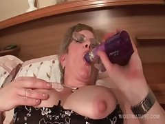 Grown up in glasses fucks herself with big dildo
