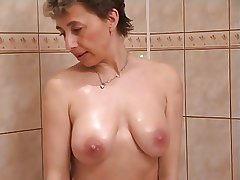 Horny milf on touching shower copulation