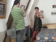Old mature in red underclothing takes two cocks