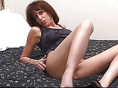 Horny mature in heels strips then stuffs playthings in the brush succulent sinistral pussy