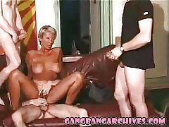Gangbang Archive - tanned mature MILF holiday gangbanging papa