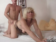 Full-grown blonde takes it from behind