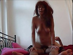 Redhead Mom in stockings blowing cock and bonking
