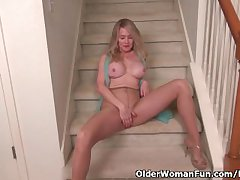 American milf Eva Griffin fingers the brush nyloned wet pussy
