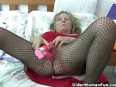 Granny with heavy tits wears pantyhose as she fucks a dildo