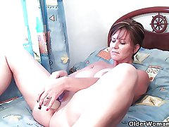Nifty grandma pushes dildo concerning her ass