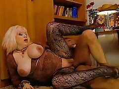 Slutty Granny Zhanna in stockings rewards voyeur thither a fuck
