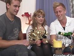 Old bitch takes two stiff cocks desired