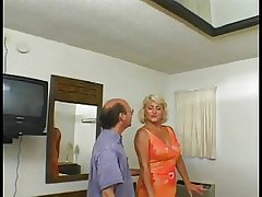 Blonde granny with a shaved pussy loves it when younger guy fucks her ass