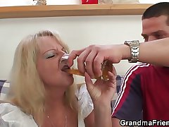 Blonde grandma swallows three big dicks