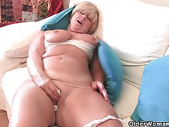 Granny with fat tits masturbates with her sex toy collection