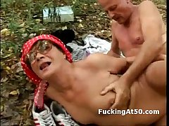 Sex-crazed granny with glasses making out husband with the forest