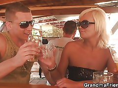 Two dudes have fun with very ancient granny