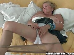Granny hither big tits masturbates forth pantyhose