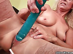 Sultry doyen mom probes her old pussy with a wide-ranging dildo