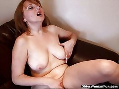 Well-endowed female parent rubs the brush adult clit