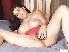 Busty materfamilias loves toys in hairy pussy