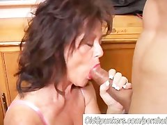 Gorgeous matured mollycoddle gives a blowjob task
