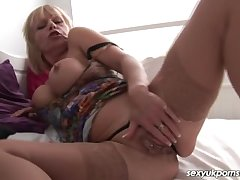 Adult British pornstar plays roughly her pussy near stockings
