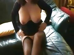 mature brunette in stockings sucks cock