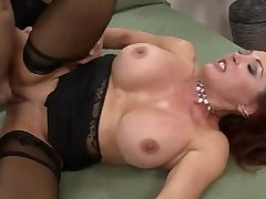 Mature Redhead Seduces Young