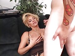 Indecorous blond mature deep throats a long hard uninspired cock