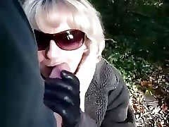 Mature sucks a scrounger while on foot close to the forest
