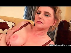 Granny with big tits with an increment of hairy pussy fucks a dildo