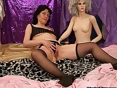 Mature dildo play with respect to a doll