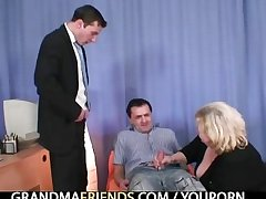 Blonde granny gets slammed by two dicks