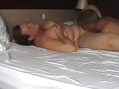 mature coupling carrying-on in bed